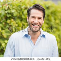 stock-photo-young-happy-man-smiling-at-camera-in-the-grape-fields-307284695